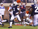 Virginia quarterback Bryce Perkins (3) runs for a touchdown during the second quarter of an NCAA college football game against Old Dominion in Charlottesville, Va., Saturday, Sept. 21, 2019. (AP Photo/Andrew Shurtleff)