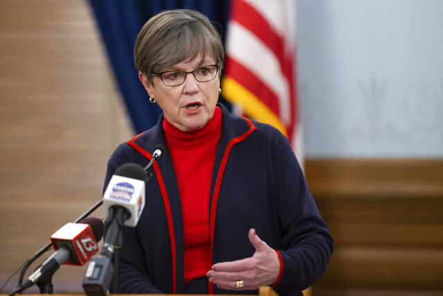 FILE - In this Tuesday, Dec. 22, 2020, file photo, Kansas Gov. Laura Kelly answers questions regarding her testing strategy and number of COVID-19 cases during a news conference at the Statehouse in Topeka Kan. The coronavirus pandemic prompted Kelly to give her 2021 State of the State address virtually, rather than during a joint session of the Legislature. (Evert Nelson/The Topeka Capital-Journal via AP, File)
