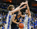 Marquette's Markus Howard (0) is defended by Creighton's Samson Froling, left, and Mitch Ballock (24) during the first half of an NCAA college basketball game in Omaha, Neb., Wednesday, Jan. 9, 2019. (AP Photo/Nati Harnik)
