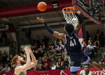 Villanova forward Saddiq Bey (41) and Saint Joseph's forward Anthony Longpre (12) reach for a rebound during the second half of an NCAA college basketball game, Saturday, Dec. 7, 2019, in Philadelphia. Villanova won 78-66. (AP Photo/Laurence Kesterson)
