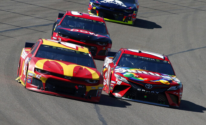 Kyle Larson (42) and Kyle Busch (18) race out of Turn 4 during the NASCAR Cup Series auto race at ISM Raceway, Sunday, March 10, 2019, in Avondale, Ariz. (AP Photo/Ralph Freso)