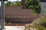 A sign stands at Dixie State University on Tuesday, June 30, 2020, in St. George, Utah. After years of resisting calls to change its name, the university is considering dropping the term Dixie as another example of the nation's reexamination of symbols associated with the Confederacy and the enslavement of Black people. (Chris Caldwell/The Spectrum via AP)