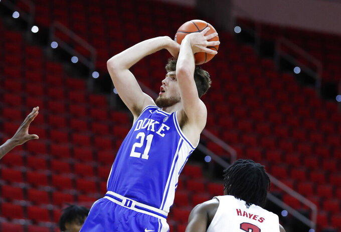 FILE - Duke's Matthew Hurt (21) shoots against North Carolina State during the second half of an NCAA college basketball game at PNC Arena in Raleigh, N.C., in this Saturday, Feb. 13, 2021, file photo. Hurt was named to The AP All-ACC first team, announced Tuesday, March 9, 2021. (Ethan Hyman/The News & Observer via AP)