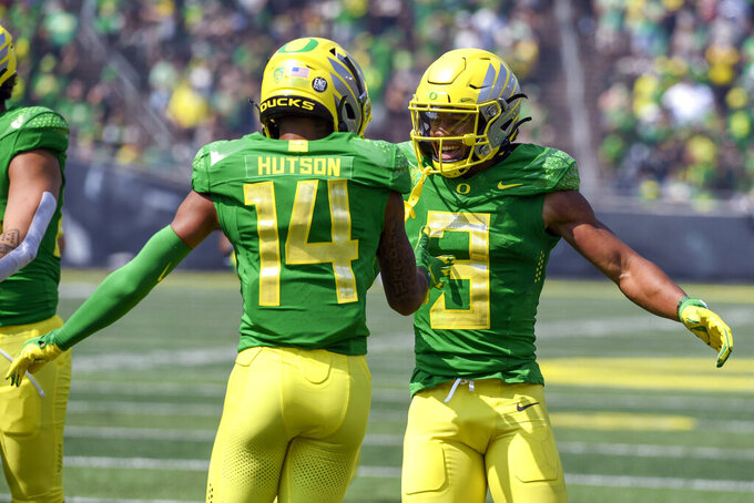 Oregon wide receiver Johnny Johnson III (3) celebrates his touchdown with Oregon wide receiver Kris Hutson (14) during the second quarter of an NCAA college football game against Fresno State, Saturday, Sept. 4, 2021, in Eugene, Ore. (AP Photo/Andy Nelson)