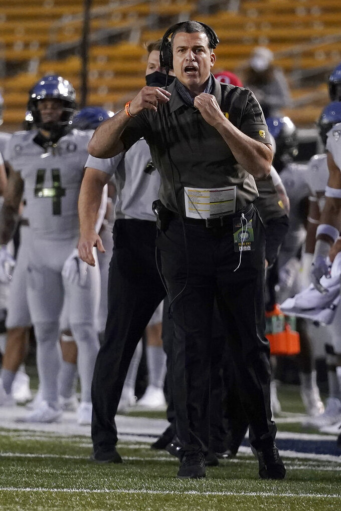 Oregon head coach Mario Cristobal gestures toward players during the first half of an NCAA college football game against California in Berkeley, Calif., Saturday, Dec. 5, 2020. (AP Photo/Jeff Chiu)