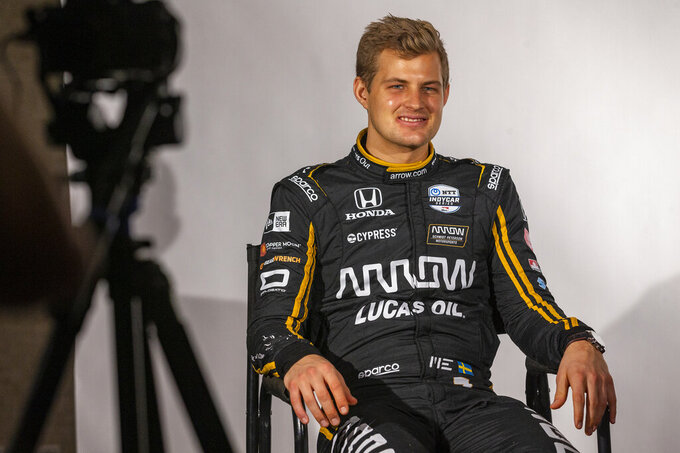 FILE - In this Feb. 11, 2019, file photo, IndyCar driver Marcus Ericsson, of Sweden, is interviewed during IndyCar auto racing media day, in Austin, Texas. The IndyCar season opens Sunday, March 10, 2019, in St. Petersburg, Fla. Among the newcomers are Felix Rosenqvist, the new teammate to Dixon at Chip Ganassi Racing, and Marcus Ericsson, who fills Robert Wickens' seat at Arrow Schmidt Peterson Motorsports. (AP Photo/Stephen Spillman, File)