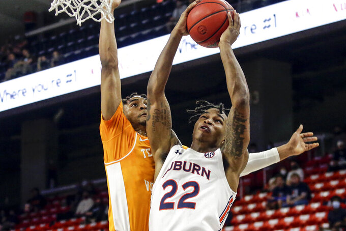 Auburn guard Allen Flanigan (22) is fouled by Tennessee guard Keon Johnson (45) as he puts up a shot during the first half of an NCAA basketball game Saturday, Feb. 27, 2021, in Auburn, Ala. (AP Photo/Butch Dill)