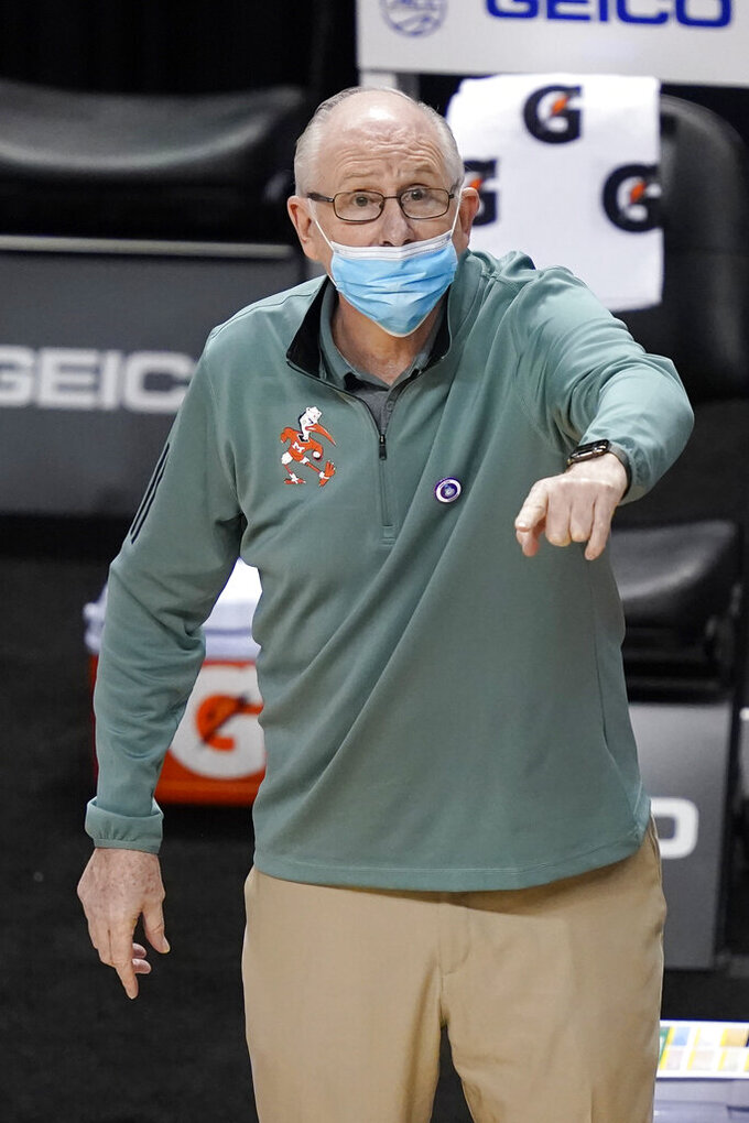 Miami head coach Jim Larranaga directs his team during the first half of an NCAA college basketball game against Georgia Tech in the quarterfinal round of the Atlantic Coast Conference tournament in Greensboro, N.C., Thursday, March 11, 2021. (AP Photo/Gerry Broome)