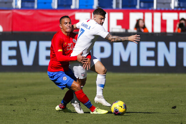 Costa Rica midfielder David Guzman (20) grabs United States forward Paul Arriola (7) during the first half of an international friendly soccer match in Carson, Calif., Saturday, Feb. 1, 2020. (AP Photo/Ringo H.W. Chiu)