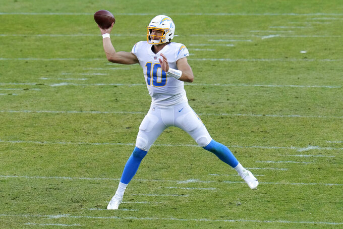 Los Angeles Chargers quarterback Justin Herbert (10) throws during the second half of an NFL football game against the Denver Broncos, Sunday, Nov. 1, 2020, in Denver. (AP Photo/Jack Dempsey)