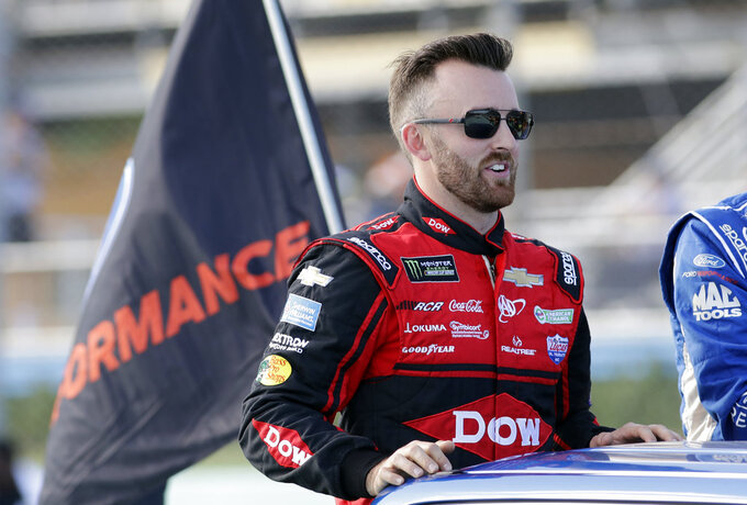 Austin Dillon goes to his car before the NASCAR Series Championship auto race at the Homestead-Miami Speedway, Sunday, Nov. 18, 2018, in Homestead, Fla. (AP Photo/Lynne Sladky)