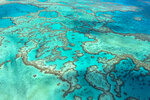 In this undated photo provided by the Great Barrier Reef Marine Park Authority, Hardy Reef, part of the Great Barrier Reef, is viewed from the air off the coast of Australia. Australia on Friday, July 23, 2021, garnered enough international support to defer for two years an attempt by the United Nations' cultural organization to downgrade the Great Barrier Reef's World Heritage status. (Jumbo Aerial Photography/Great Barrier Reef Marine Park Authority via AP)