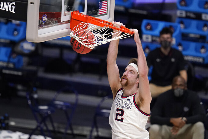 Gonzaga forward Drew Timme (2) dunks against Creighton in the second half of a Sweet 16 game in the NCAA men's college basketball tournament at Hinkle Fieldhouse in Indianapolis, Sunday, March 28, 2021. (AP Photo/Michael Conroy)