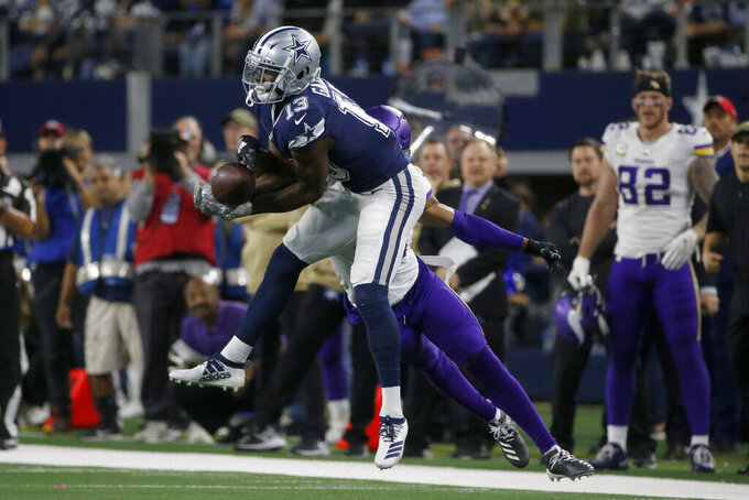 Dallas Cowboys wide receiver Michael Gallup (13) catches a pass in front of Minnesota Vikings' Mike Hughes during the second half of an NFL football game in Arlington, Texas, Sunday, Nov. 10, 2019. (AP Photo/Michael Ainsworth)