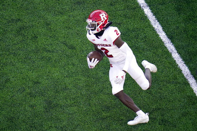 Rutgers wide receiver Aron Cruickshank runs with the ball against Maryland during the second half of an NCAA college football game, Saturday, Dec. 12, 2020, in College Park, Md. Rutgers won 27-24 in overtime. (AP Photo/Julio Cortez)