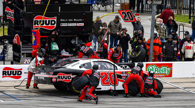 Driver Christopher Bell's pit crew service his car during a pit stop in a NASCAR auto race at Texas Motor Speedway, Saturday, March 30, 2019, in Fort Worth, Texas. (AP Photo/Larry Papke)