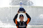 Pato O'Ward celebrates after winning the second race of the IndyCar Detroit Grand Prix auto racing doubleheader on Belle Isle in Detroit Sunday, June 13, 2021. (AP Photo/Paul Sancya)