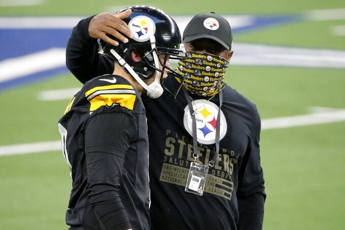 Pittsburgh Steelers' Chris Boswell (9) talks with head coach Mike Tomlin, right, after Boswell kicked a field goal late in the first half of an NFL football game against the Dallas Cowboys in Arlington, Texas, Sunday, Nov. 8, 2020. (AP Photo/Michael Ainsworth)