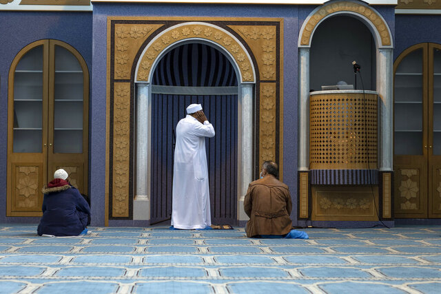 Muslims who live in Greece pray inside the first state-funded mosque in Athens on Friday, Nov. 6, 2020. Friday prayers have been held for the first time in the Greek capital's first state-sponsored mosque, which opened this week after years-long delays. The project to build a mosque in Athens has taken about 14 years and was dogged by protests, political controversy and delays in this heavily Christian Orthodox country. (AP Photo/Petros Giannakouris)