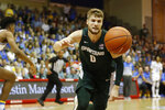 Michigan State guard Kyle Ahrens (0) chases down a loose ball during the first half of an NCAA college basketball game against UCLA, Wednesday, Nov. 27, 2019, in Lahaina, Hawaii. (AP Photo/Marco Garcia)