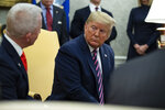FILE - In this Dec. 19, 2019 photo, President Donald Trump, right, meets with Rep. Jeff Van Drew in the Oval Office of the White House in Washington.  President Donald Trump is coming next week to the Jersey shore to reward newly minted Republican Rep. Jeff Van Drew for leaving the Democrats and opposing impeachment and is expected to attract a crowd and headlines. But Van Drew has also been crisscrossing the district to secure support from local GOP  that he spent years fighting.  (AP Photo/ Evan Vucci, File)