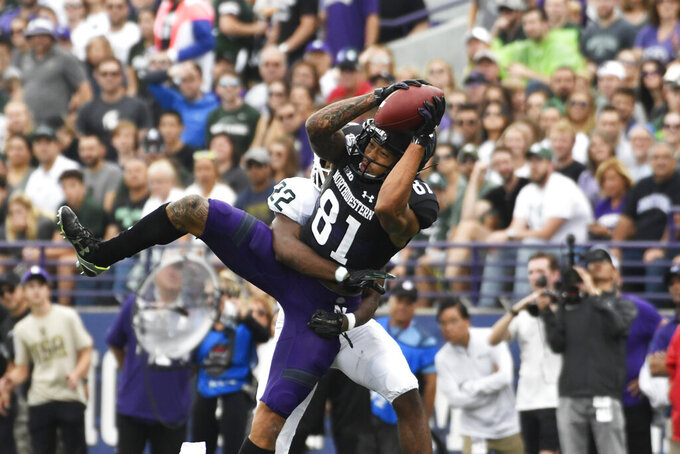 Northwestern wide receiver Ramaud Chiaokhiao-Bowman (81) makes a catch as Michigan State cornerback Josiah Scott (22) defends him during the first half of an NCAA college football game, Saturday, Sept. 21, 2019, in Evanston, Ill. (AP Photo/David Banks)