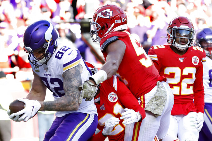 Minnesota Vikings tight end Kyle Rudolph (82) makes a touchdown catch against Kansas City Chiefs cornerback Bashaud Breeland (21), safety Juan Thornhill (22) and linebacker Damien Wilson (54) during the second half of an NFL football game in Kansas City, Mo., Sunday, Nov. 3, 2019. (AP Photo/Colin E. Braley)