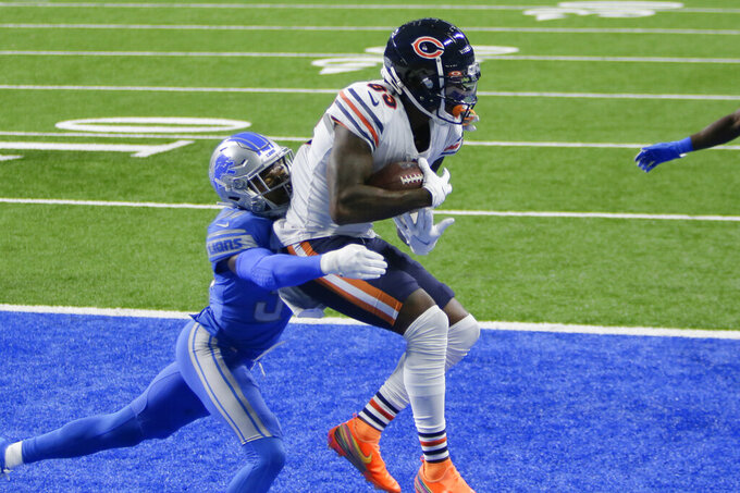 Chicago Bears wide receiver Javon Wims (83) catches a one-yard touchdown pass as Detroit Lions cornerback Tony McRae (34) defends in the second half of an NFL football game in Detroit, Sunday, Sept. 13, 2020. (AP Photo/Duane Burleson)
