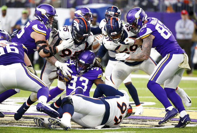 Minnesota Vikings running back Dalvin Cook (33) is tackled by Denver Broncos defenders during the second half of an NFL football game, Sunday, Nov. 17, 2019, in Minneapolis. (AP Photo/Bruce Kluckhohn)