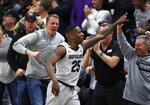 Colorado guard McKinley Wright IV, front, is congratulated by fans after hitting a basket against Oregon in the second half of an NCAA college basketball game Thursday, Jan. 2, 2020, in Boulder, Colo. (AP Photo/David Zalubowski)