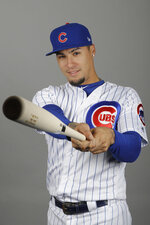 This is a 2019 photo showing Javier Baez of the Chicago Cubs baseball team. It does not take Javier Baez long to show off his magic tricks, even in a spring training game. The Chicago Cubs star singled in the first inning on Sunday, March 17, 2019, against the Colorado Rockies and stole second, escaping a tag by shortstop Garrett Hampson with a deft swim move. (AP Photo/Darron Cummings, File)