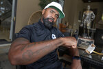 Former NFL football player Charles Woodson shows his Lombardi Trophy tattoo during an interview at his home, Tuesday, June 15, 2021, in Orlando, Fla. (AP Photo/Phelan M. Ebenhack)