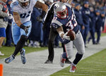New England Patriots running back Dion Lewis (33) tiptoes along the sideline as Tennessee Titans linebacker Derrick Morgan (91) pursues during the second half of an NFL divisional playoff football game, Saturday, Jan. 13, 2018, in Foxborough, Mass. (AP Photo/Steven Senne)