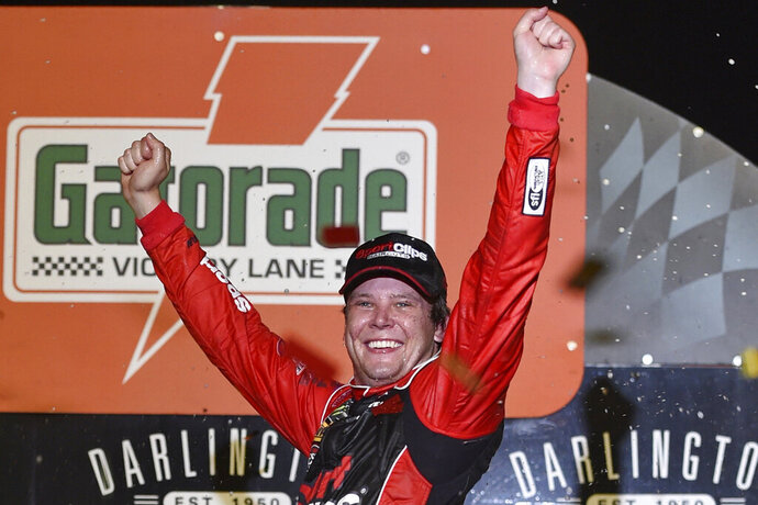 Erik Jones celebrates his victory after a NASCAR Cup Series auto race on Sunday, Sept. 1, 2019, at Darlington Raceway in Darlington, S.C. Jones held off Joe Gibbs Racing teammate Kyle Busch to win the rain-delayed Southern 500 that ended early Monday morning. (AP Photo/Richard Shiro)