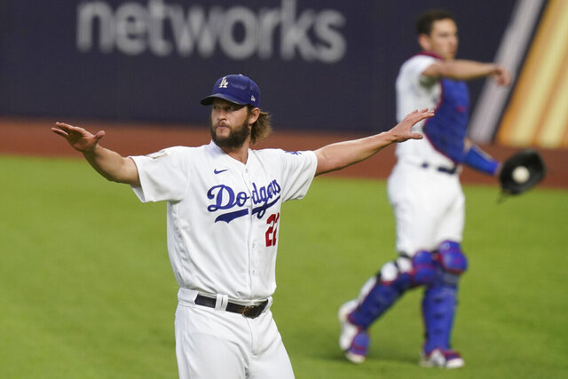 Los Angeles Dodgers starting pitcher Clayton Kershaw warms up before Game 1 of the baseball World Series against the Tampa Bay Rays Tuesday, Oct. 20, 2020, in Arlington, Texas. (AP Photo/Eric Gay)