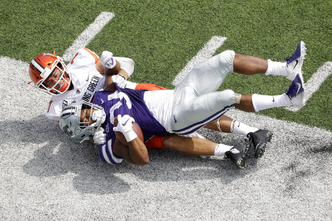 Bowling Green defensive back Jerry McBride III (7) tackles Kansas State running back James Gilbert (34) just short of the end zone after a long run by Gilbert setting up a touchdown during the first half of an NCAA college football game Saturday, Sept. 7, 2019, in Manhattan, Kan. (AP Photo/Charlie Riedel)