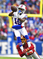 Buffalo Bills wide receiver John Brown (15) cannot hold onto the ball as Washington Redskins cornerback Josh Norman, bottom, defends during the second half of an NFL football game Sunday, Nov. 3, 2019, in Orchard Park, N.Y. (AP Photo/Adrian Kraus)