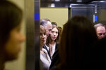 Fabiana Rosales de Guaido, wife of Venezuela's self-proclaimed interim president Juan Guaido, stands inside an elevator after attending a conference at the Autonomous University of Chile in Santiago, Chile, Wednesday, March 20, 2019. Rosales is in Chile for the Democracy Forum Santiago 2019. (AP Photo/Esteban Felix)