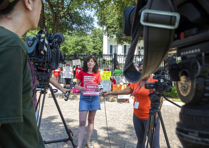 Nicole Golden, a spokesperson for Moms Demand Action, speaks to members of the media during a protest in front of the Texas Governor's Mansion, Thursday, June 17, 2021, in Austin, Texas, after Gov. Greg Abbott signed a bill Wednesday that would allow Texans who are 21 years old or older to carry handguns without a permit. The permit-less carry measure will go into effect Sept. 1. (Ana Ramirez/Austin American-Statesman via AP)