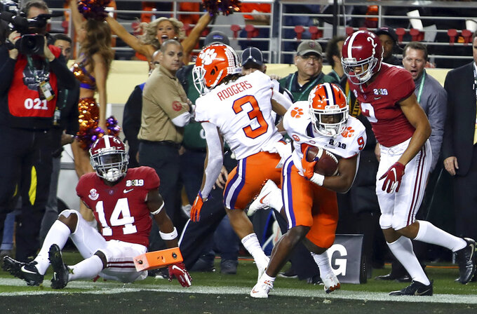 Clemson's Travis Etienne reacts after rushing for a touchdown during the first half the NCAA college football playoff championship game against Alabama, Monday, Jan. 7, 2019, in Santa Clara, Calif. (AP Photo/Ben Margot)