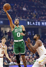 Boston Celtics' Jayson Tatum, left, shoots against Cleveland Cavaliers' Tristan Thompson in the first half of an NBA basketball game, Tuesday, Nov. 5, 2019, in Cleveland. (AP Photo/Tony Dejak)