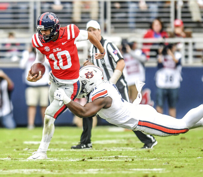 Mississippi quarterback Jordan Ta'amu (10) is tackled by Auburn defensive lineman Nick Coe (91) during an NCAA college football game at Vaught-Hemingway Stadium in Oxford, Miss., Saturday, Oct. 20, 2018. (Bruce Newman/The Oxford Eagle via AP)