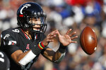 Cincinnati quarterback Desmond Ridder takes the snap in the first half of an NCAA college football game against Navy, Saturday, Nov. 3, 2018, in Cincinnati. (AP Photo/John Minchillo)