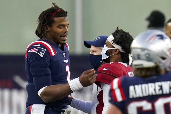 New England Patriots quarterback Cam Newton, left, and Arizona Cardinals quarterback Kyler Murray, right, speak at midfield after an NFL football game, Sunday, Nov. 29, 2020, in Foxborough, Mass. (AP Photo/Charles Krupa)