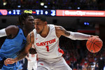 Rhode Island's Jermaine Harris defends against Dayton's Obi Toppin during the first half of an NCAA college basketball game, Tuesday, Feb. 11, 2020, in Dayton, Ohio. (AP Photo/Aaron Doster)