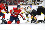 Washington Capitals center Lars Eller (20), of Denmark, and Vegas Golden Knights center Nicolas Roy (10) battle for the puck during the second period of an NHL hockey game, Saturday, Nov. 9, 2019, in Washington. (AP Photo/Nick Wass)