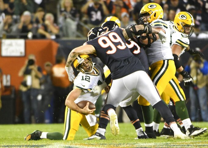 Green Bay Packers' Aaron Rodgers is hit by Chicago Bears' Aaron Lynch during the second half of an NFL football game Thursday, Sept. 5, 2019, in Chicago. (AP Photo/David Banks)