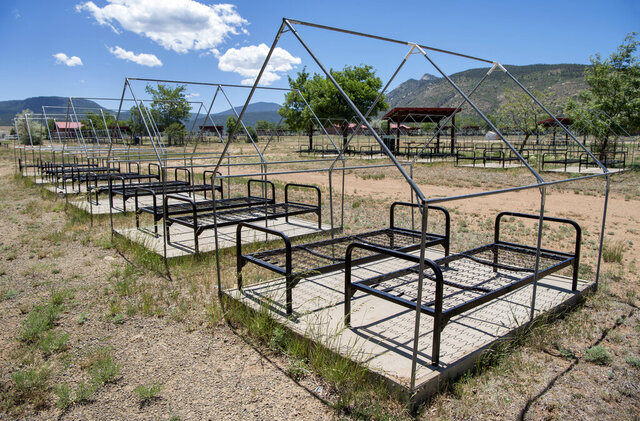 In a Wednesday June 10, 2020 photo, hundreds of tent pads remain empty where normally thousands of Boy Scouts would be arriving at and departing Philmont Scout Ranch in Colfax County, New Mexico. On June 4, the camp announced all 2020 summer programs would be canceled. (Eddie Moore/Albuquerque Journal)/The Albuquerque Journal via AP)