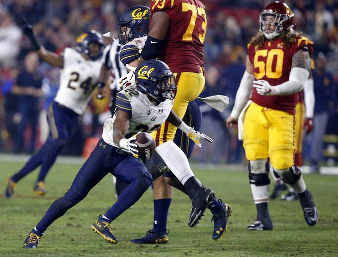 California cornerback Traveon Beck (22) celebrates after intercepting a Southern California pass during the second half of an NCAA college football game in Los Angeles, Saturday, Nov. 10, 2018. California won 15-14. (AP Photo/Alex Gallardo)