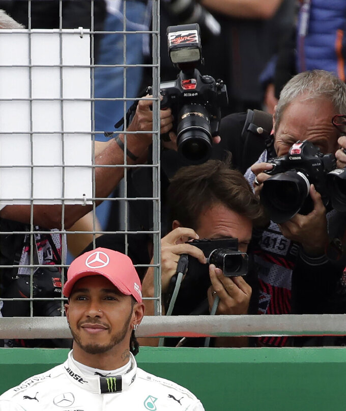 Second placed Mercedes driver Lewis Hamilton of Britain smiles after the qualifying session at the Silverstone racetrack, in Silverstone, England, Saturday, July 13, 2019. The British Formula One Grand Prix will be held on Sunday. (AP Photo/Luca Bruno)